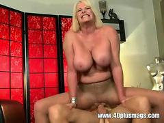 Busty mature MILF in ripped nylon pantyhose rides a dick