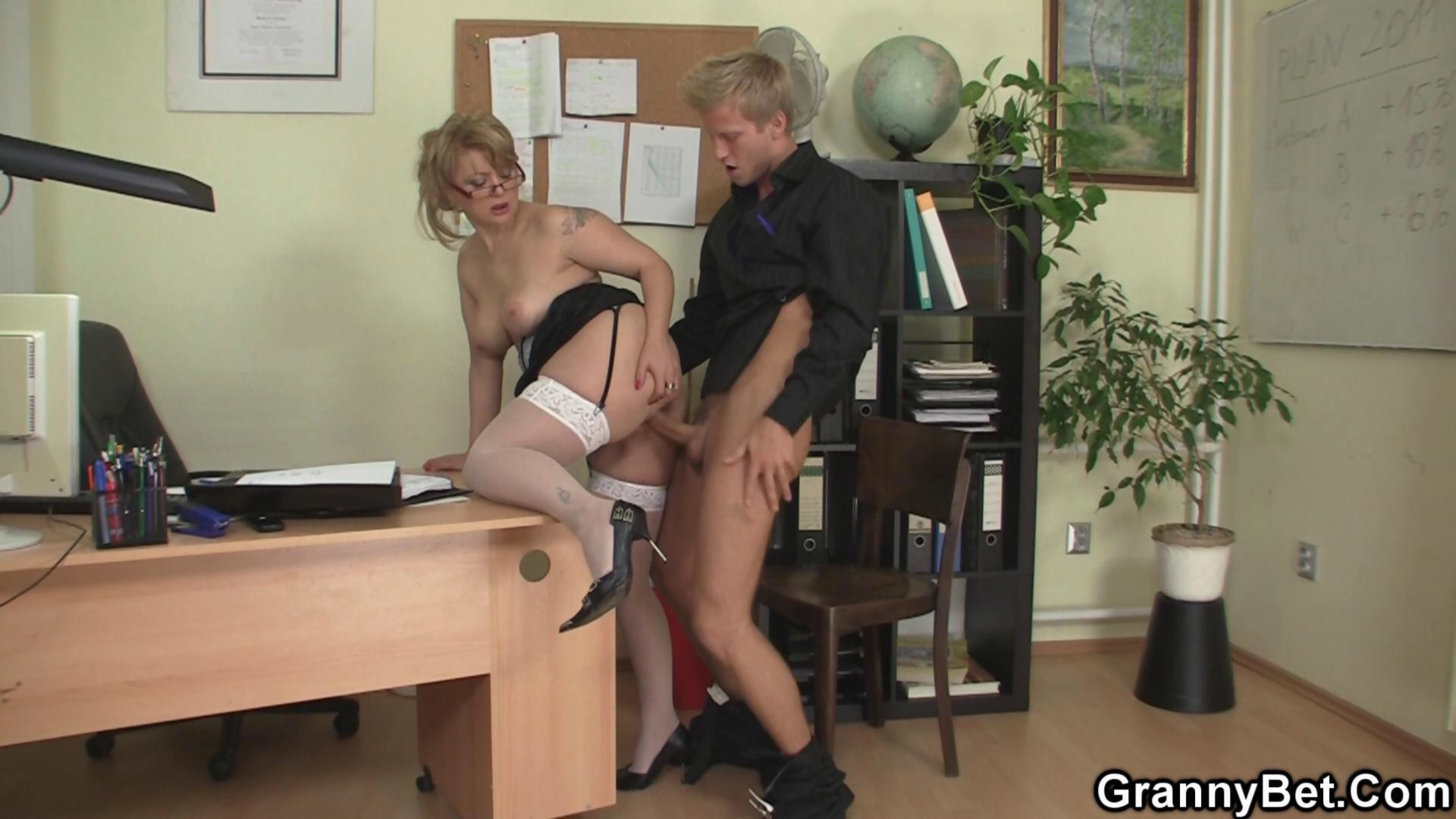 Woman having sex in the office