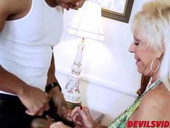 Old blonde Mandy McGraw fucked by a big black guy in her master bedroom