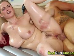 Cute ginger babe gives an awesome Nuru massage