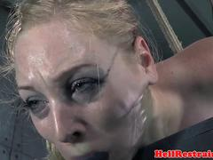Stockinged bdsm sub caned while in pillory