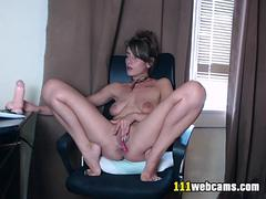 Sexy busty MILF camgirl with big nipples dildoing on webcam
