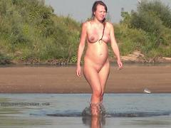 Nudist girls expose bodies at the beach