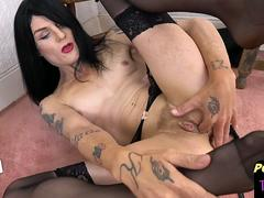 Tattooed post op tranny fingers her pussy