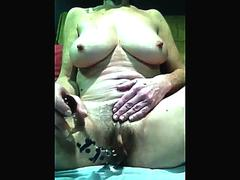 Older with bushy pussy and enormous titties provokes via camera