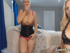 Two Lesbian Babes Sucking Dildo On Cam