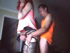 She is a sissy crossdresser getting hard fucked in the ass standing up with erected cock