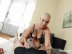 Shaved headed whore rides hard cock