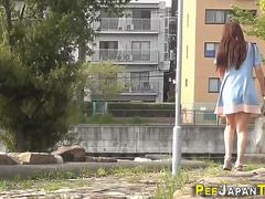 Asian in boots urinates